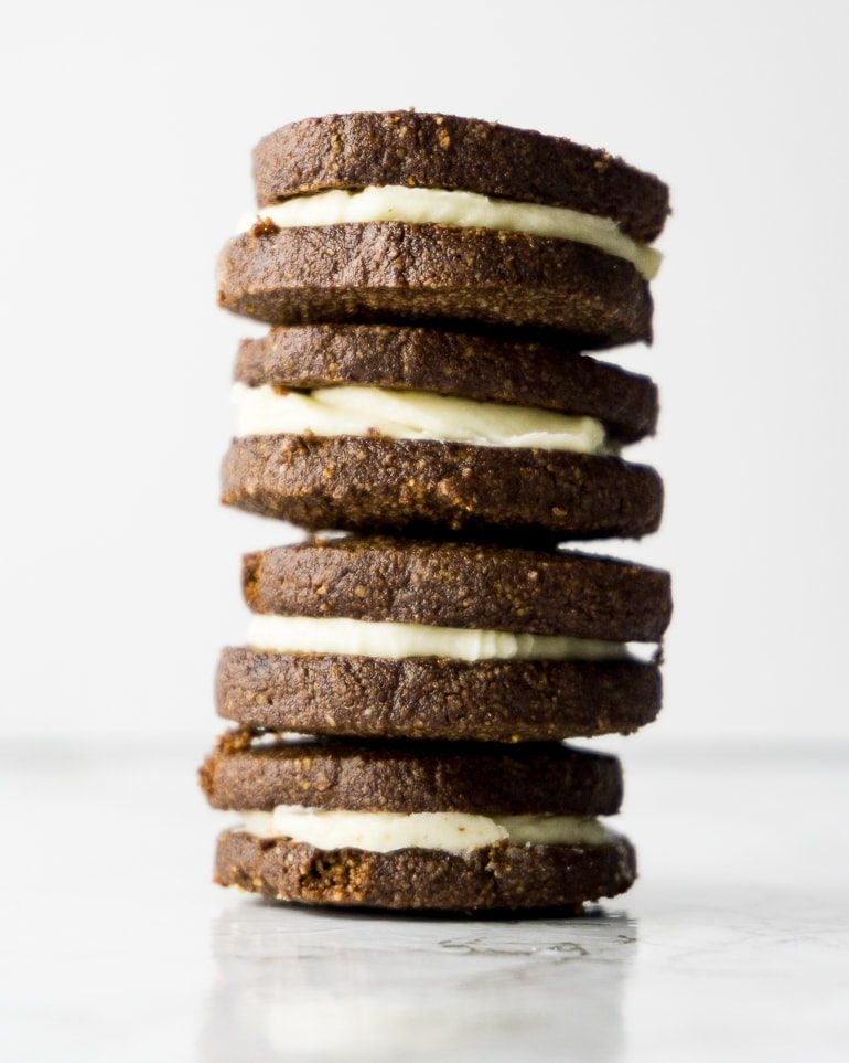 """stack of 4 chocolate """"oreo"""" sandwich cookies made keto with almond flour"""