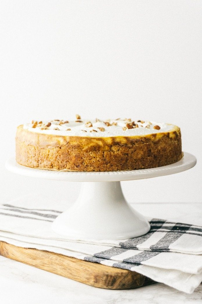 pumpkin cheesecake with whipped cream and pecans