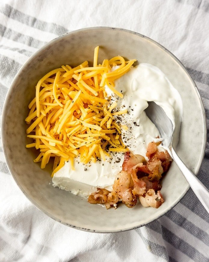 ingredients for keto cauliflower casserole with cheese, bacon, and sour cream