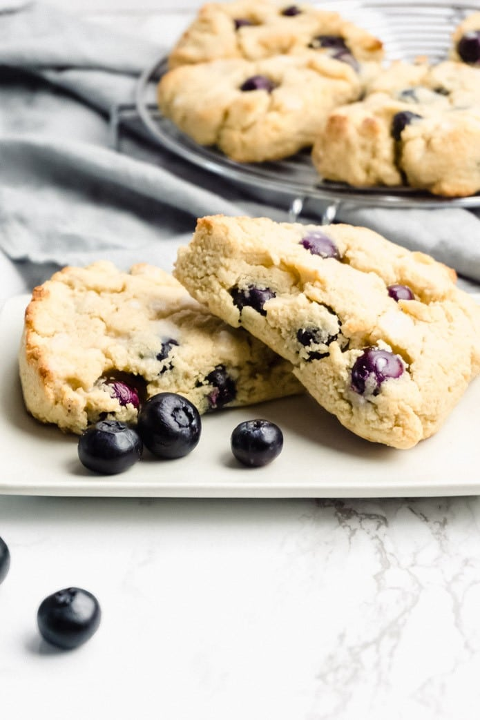 low-carb gluten-free blueberry scones on a white plate