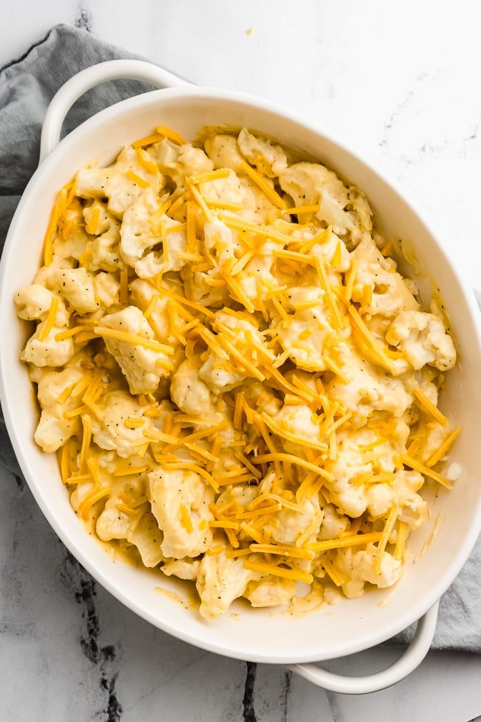 cauliflower topped with cheese sauce and extra cheddar cheese