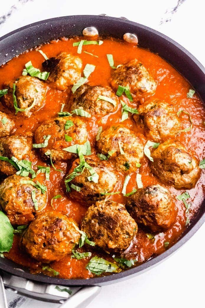 low-carb meatballs in keto tomato sauce with basil