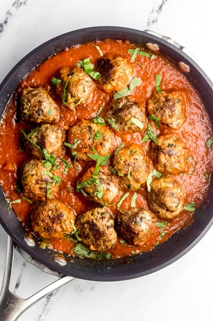 pan of keto meatballs in low-carb tomato sauce