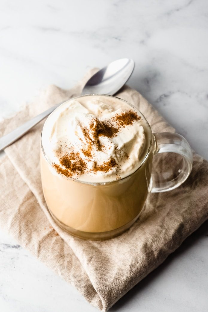 keto pumpkin spice latte topped with whipped cream and cinnamon