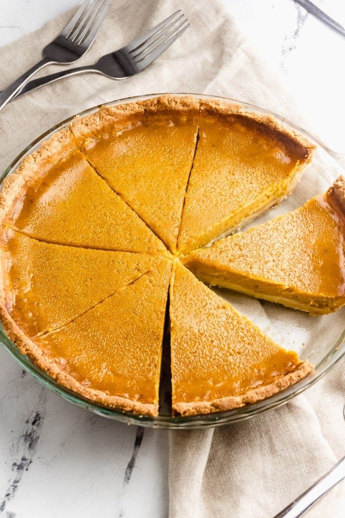 cut slices of keto pumpkin pie with low-carb gluten-free crust