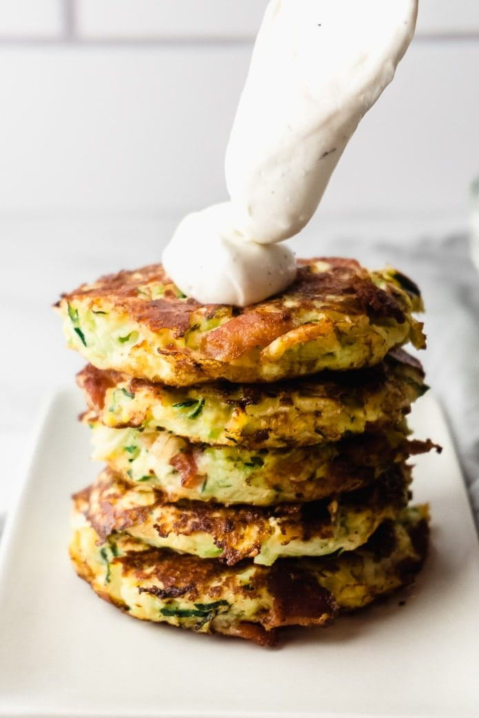 stack of keto zucchini fritters with sour cream