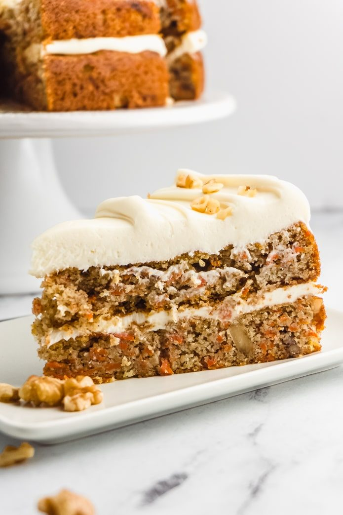 slice of keto carrot cake with cream cheese frosting