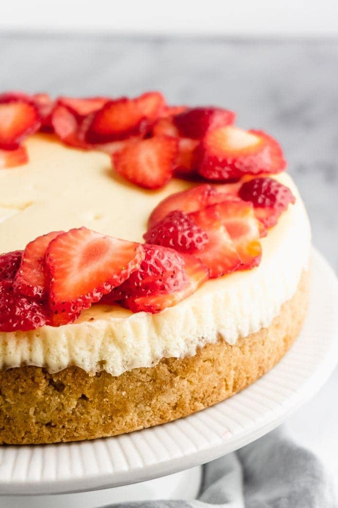 low-carb cheesecake with sliced strawberries and almond flour crust