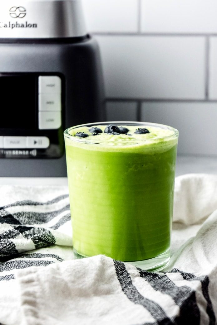 low carb green smoothie topped with blueberries