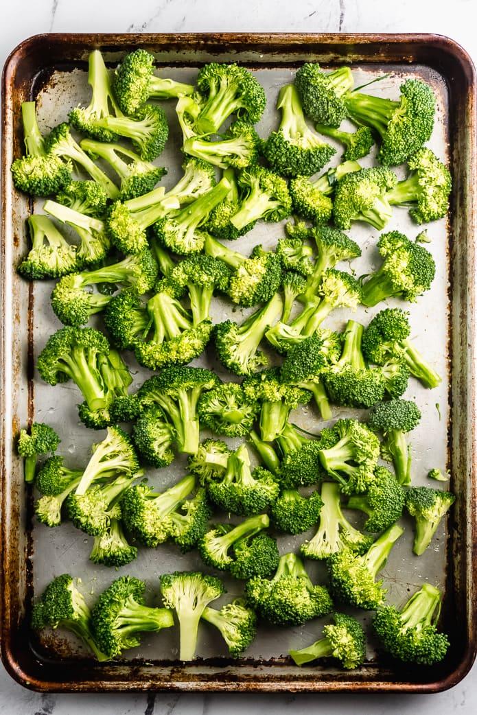 raw broccoli on a sheet pan