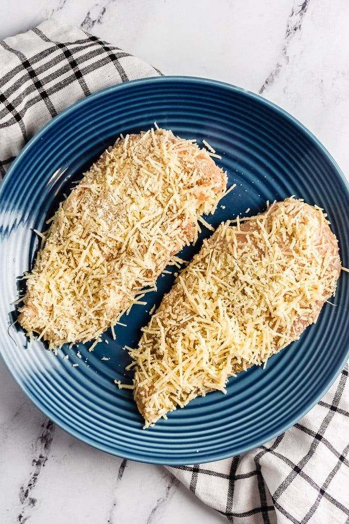 two chicken breast cutlets breaded in low-carb parmesan cheese