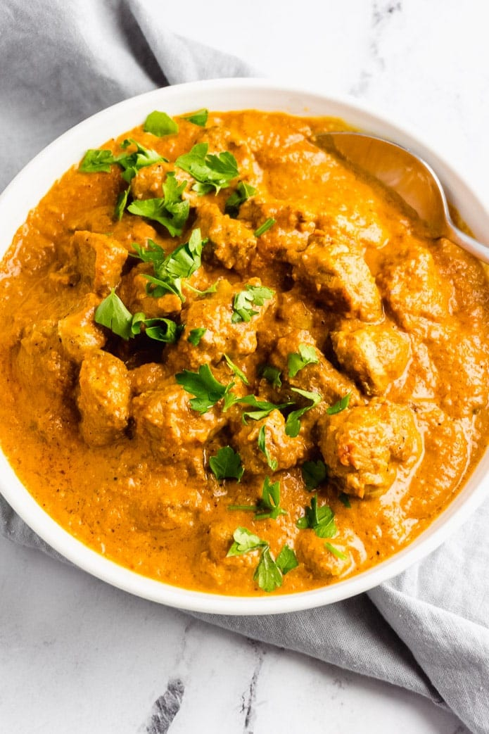 low-carb butter chicken with a spoon in a bowl